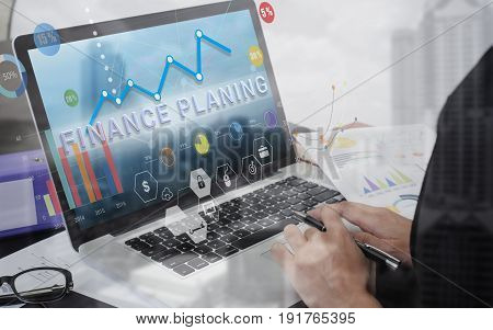business hand typing on computer keyboard with Finance planing homepage on screen financial and banking website web page concept.