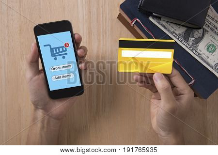 business hand holding credit card with smart phone and Shopping online. concept mobile banking e-commerce internet technology.