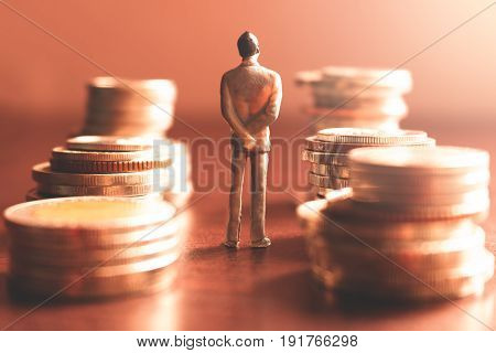 Miniature people standing with stack coin about financial and money savings concept.