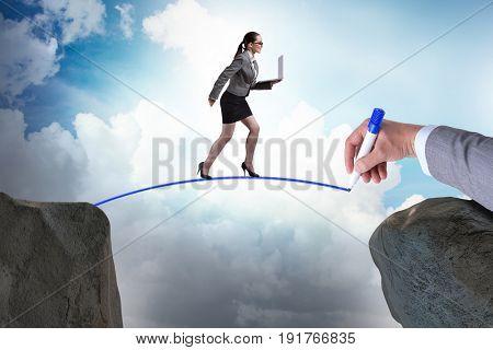 Hand drawing bridge under businesswoman