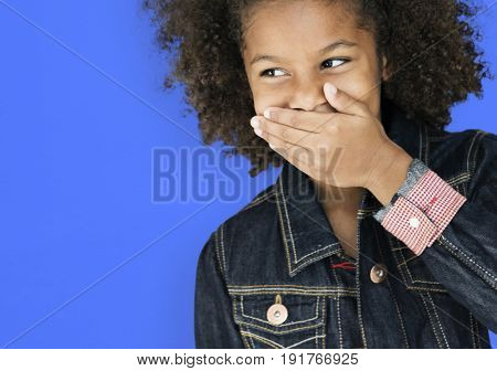 Mixed race kid giggling and laughing