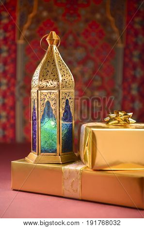 Special Eid gift and Ramadan Lantern. Islamic custom of celebrating festival by giving away gifts and sweet.