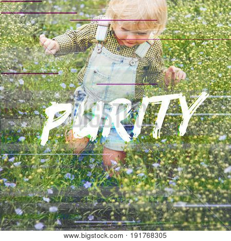 Purity word on blonde boy in the meadow