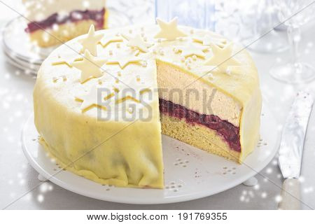 Marzipan christmas torte with hazelnut cream layer and white chocolate star decoration