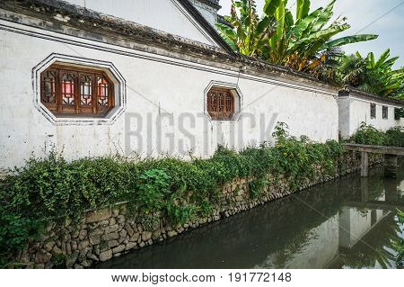 perspective view of  traditional white cement wall by river,Beijing,China.