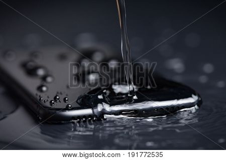 closeup water drop on phone device waterproof concept