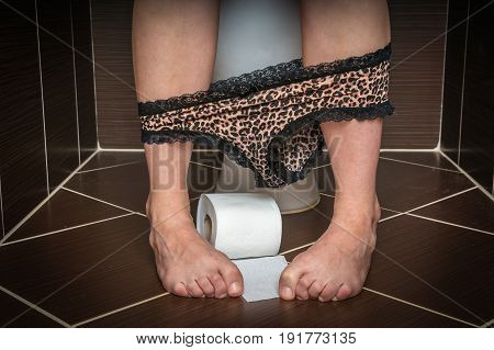 Woman Suffers From Diarrhea Is Sitting On Toilet Bowl