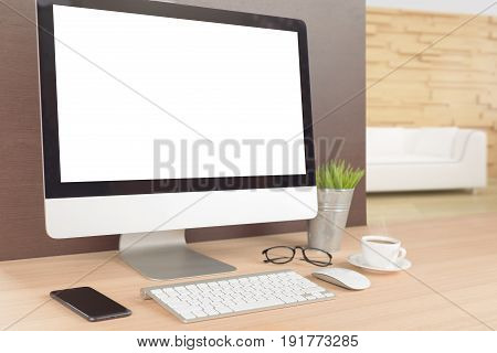 desktop computer on work table showing white screen perspective angle view