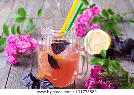 Variety of lemonade in mason jars with with lemon