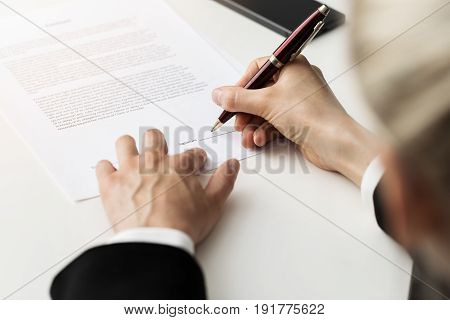 woman putting signature on business partnership contract