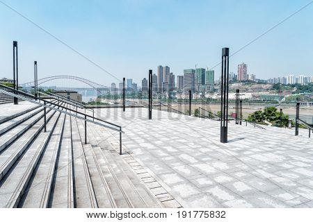 empty floor by river with cityscape of chongqing