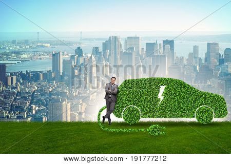 Businessman in green electric car concept