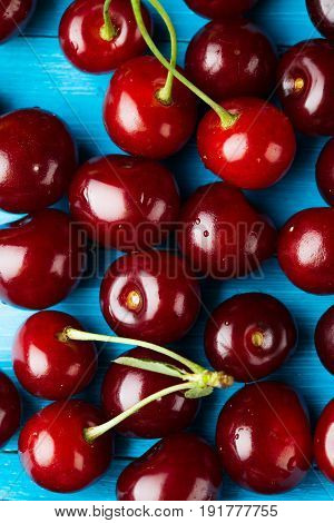 crowded group of ripe cherries, making approach. studio shot