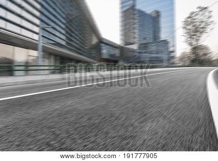 empty asphalt road travel through downtown city,shanghai,china.
