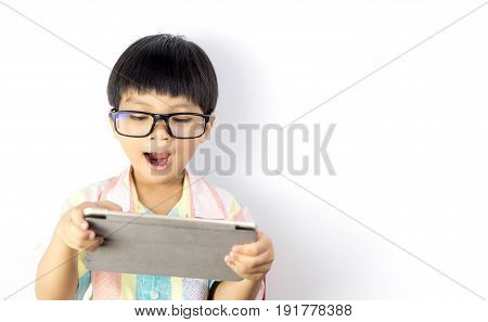 Nerdy Asian boy is surprising on what on the tablet