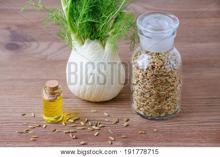fennel essential oil bulb and seeds selective focus