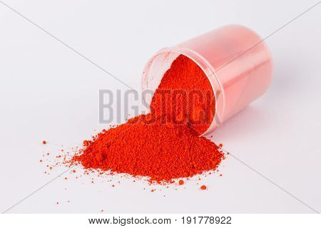 cadmium red light pigment on a white background
