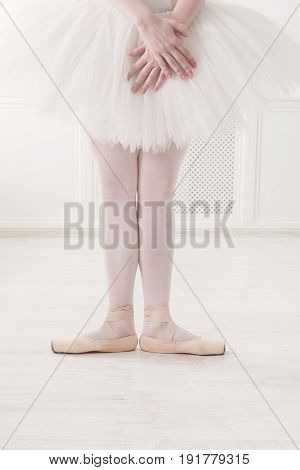 Ballerina legs first position in pointe, ballet dancer concept background