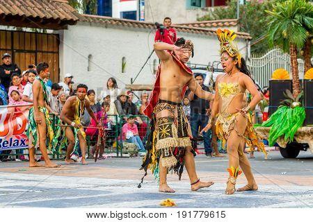 Banos De Agua Santa Ecuador - 29 November 2014: Indigenous Woman Dancer Is Dancing On The Streets Of Banos De Agua Santa South America Christmas Holiday On November 29 2014