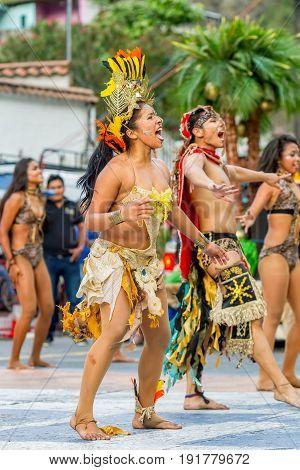 Banos De Agua Santa Ecuador - 29 November 2014: Group Of Traditional Huaorani People Performing Folk Dance On The Streets Of Banos De Agua Santa South America Christmas Holiday On November 29 2014