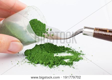 Cadmium green light pigment on a white background