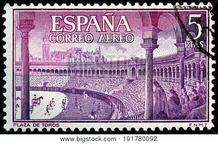LUGA RUSSIA - APRIL 26 2017: A stamp printed by SPAIN shows beautiful view of Bullring - an arena where bullfighting is performed circa 1960