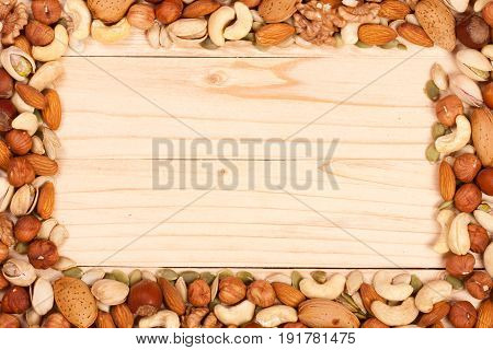 Mix of different nuts with copy space for your text. Top view.
