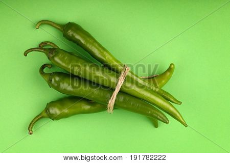 Bunch Of Jalapeno Hot Chili Peppers On Green