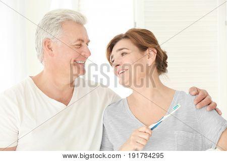 Morning of senior couple in bathroom