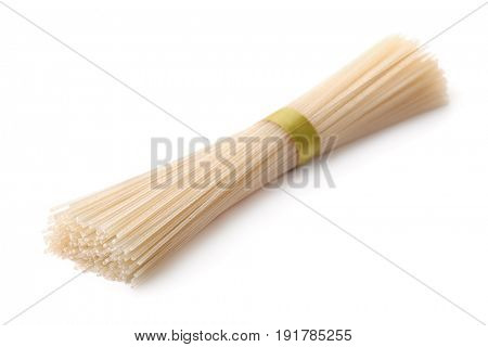 Bunch of raw rice noodles isolated on white