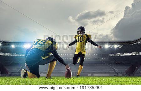 American football players at arena
