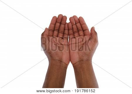 Two hand holding or offering something, isolated on white background. Open black male palms, handful gesture