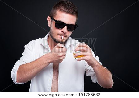 Young Gangster Drinking And Smoking