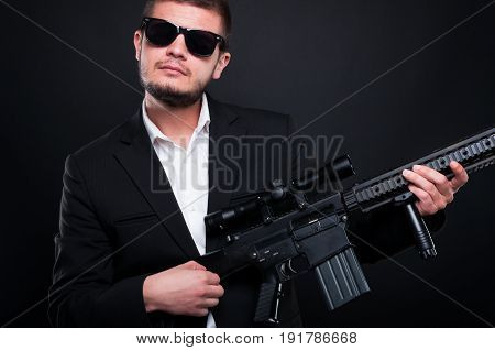 Gangster Using His Weapon To Sing On It