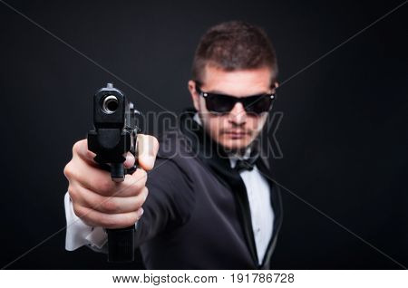 Handsome Murderer Aiming Gun To An Invisible Target