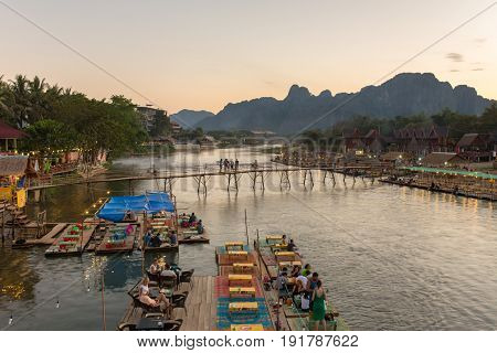 Vang Vieng, Laos - January 19, 2017: Restaurant on the riverfront during sunset in Vang Vieng, Laos