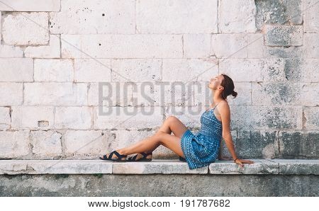 Beautiful young woman in Zadar Croatia. Summer holidays on the seacoast of Europe. Tourists walking on the old historical streets of Zadar. Lifestyles Vacation and Travel concept.