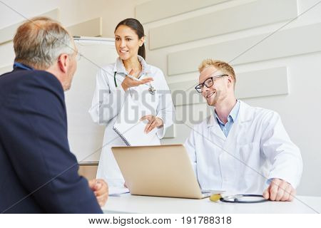 Patient in consultation with doctors about trust and competence