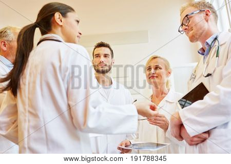 Competent team of doctors discussing during teamwork