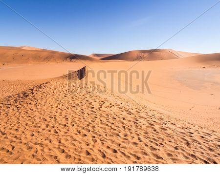 Footprints on the way to Dead Vlei on the Namib Desert Namibia. .