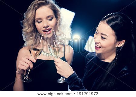 Smiling Seductive Glamour Multiethnic Girls Toasting With Champagne Glasses And Spending Time At Par