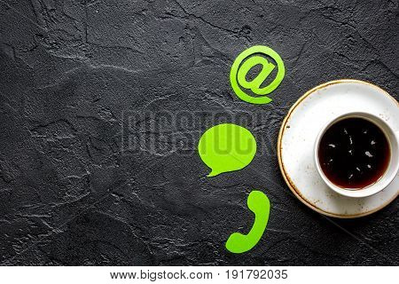 customer support company office with contact us sign and coffee on dark desk background top view mockup