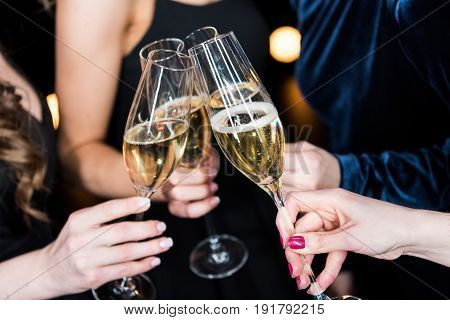 Partial View Of Women Holding Glasses With Champagne In Hands