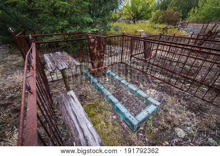 Grave in abandoned Pripyat city in Chernobyl Exclusion Zone Ukraine