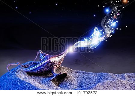 aladdin genie magic lamp on desert sand