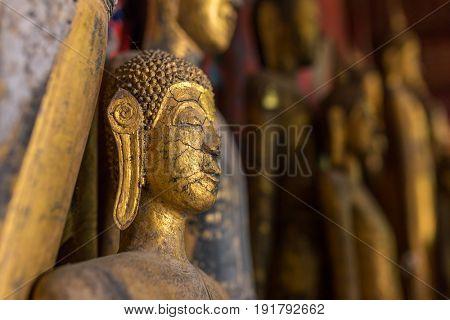 Buddha statues in Wat Xieng Thong in Luang Prabang, Laos.