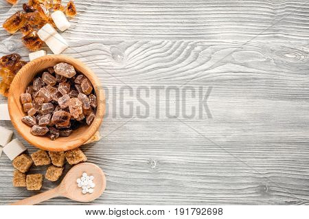lumps of sugar with bowls sweet set on light kitchen table background top view mockup