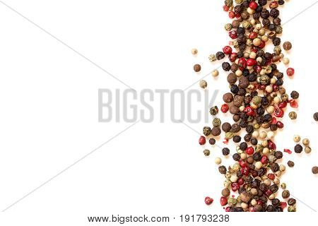 Close up mixed type of peppercorns on white background with copy space top view or overhead shot