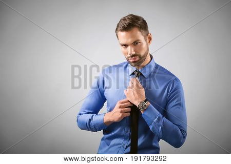 Young handsome man portrait. Confident, sexy pose with thoughtful look.