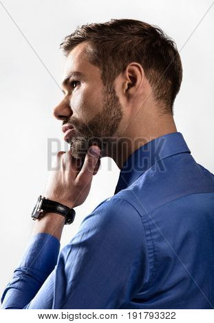 Young businessman thinking about new business ideas. White background, backlight